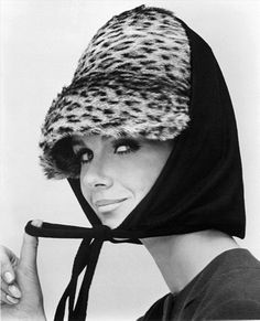 Nicole de la Marge in an Otto Lucas jersey scarf over an ocelot hat, photo by John French. London, UK, 1964