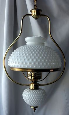 Vintage Retro 1950s Mid-Century White Hobnail Milk Glass Light Chandelier. $180.00, via Etsy.