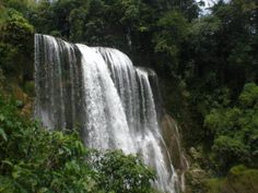 Honduras, I walked behind this water fall, it was the most beautiful thing I've ever seen!