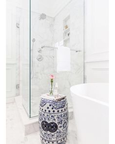 17d0d5d3b5 The combination of white and blue creates a serene style in this gorgeous  bathroom design by