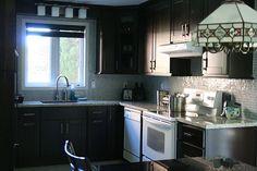 White appliances with dark cabinets
