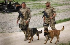German armed forces Bundeswehr soldiers walk their dogs before searching for improvised explosive devices (IED) in Kunduz April 20, 2009.
