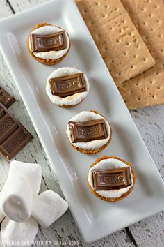 With these S'mores Cookie Cups, you can enjoy the flavor of s'mores any time! Buttery graham cracker cups filled with toasted marshmallow and topped with Hershey's Chocolate Bar, everyone will be asking for s'more!