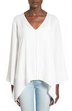 Free shipping and returns on Soprano Shark Bite Hem Top at Nordstrom.com. An open-stitched detail centers a flowing V-neck top framed with full, fluttery sleeves and a fun shark-bitehem.