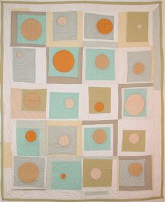 sun and moon by square one studio, via Flickr.  Beautiful pattern and hand quilting!