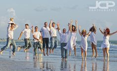 large family portraits | Big Family Candid Beach Portraits at Tradewinds Resort St. Petersburg ...