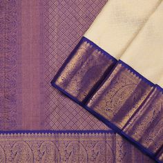 This regal kanjivaram sari in off white is handwoven with diamond enclosing peacock and chakaram buttis in gold zari, all over the body. The korvai border in ink purple shot with ink blue has peacock and geometric motifs in gold zari. Kanjivaram Sarees Silk, Dhoti Saree, Blue Silk Saree, Yellow Saree, Kanchipuram Saree, Pink Saree, Pure Silk Sarees, Anarkali, Designer Lehnga Choli