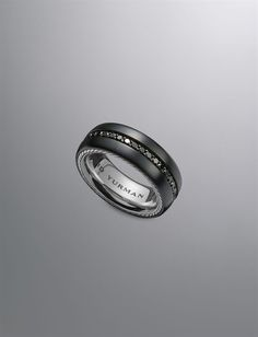 Mens wedding band- Dan liked it, but he said the metal was a little too dark. But he liked the black diamonds.