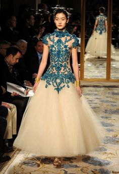 Marchesa 2012. Love the bright blue cutouts contrasting against the ivory full skirt.