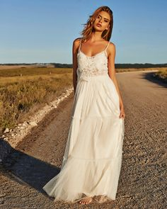 10 Beautifully Rustic Wedding Dresses. This is the only one I like out of the 10