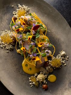 Brook trout, maple syrup, sherry vinegar, and curry squash by chef Grant Achatz of Alinea.