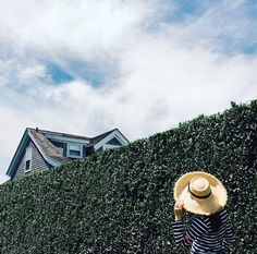 The Nantucket way.Grey shingles, green hedges, sailor shirt, and Peter Beaton hat. Sailor Shirt, Nantucket Island, Hedges, Panama Hat, Grey, Hats, Pearls, Painting, Fashion