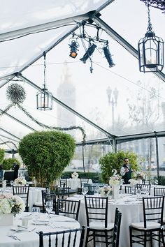 Add greenery to a clear tent for a lush feel