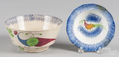 Two blue spatter bowls with peafowl decoration, 1'' h., 5 1/4'' dia. and 3'' h., 6 1/4'' dia. - Price Estimate: $40 - $80