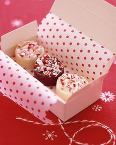Cute wrapping with candy boxes, tissue paper and baker's twine. http://www.nashvillewraps.com/candy-boxes/candy-boxes/c-048733.html http://www.nashvillewraps.com/ribbon/bakers-twine/c-024593.html