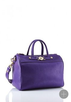 839f2138e38a Signature Medium Duffle Bag from Versace Women s Collection. Update your  classic wardrobe with this duffle bag from the Versace Signature Collection.