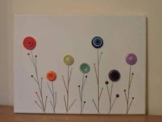 Hey, I found this really awesome Etsy listing at https://www.etsy.com/uk/listing/518932681/rainbow-button-flower-canvas