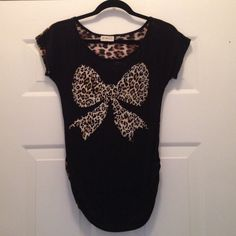 """Black Shirt-Leopard print on front & back- Size S Black Shirt with leopard print on front & back. Size S. Brand """"Free Kisses"""". Used once perfect condition Free kisses Tops Tees - Short Sleeve"""