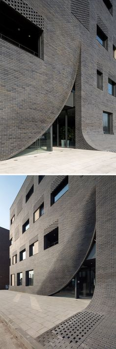 This black brick building has a 'crack' in it to reveal the entrance. On a smaller scale it would be stunning on a home