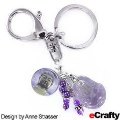 "Buddha Breathe Aromatherapy Charm eCrafty.com Anne created this aromatherapy charm when she found herself hyperventilating  about the upcoming holidays! She had our friend Tracy write the reminder to ""breathe"" and mounted that in our new 18mm charm bezel base kit.  Then she filled a glass #buddha #mini bottle with lavender essential oil and added a few #sparkle beads and #pearl dangles. #breathe #buddha #charm #bezel #diy #ecrafty #crafts"