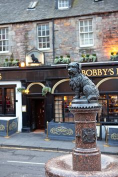 Statue of John Gray's Skye terrier, known as Grey Friers Bobby, who spent fourteen years guarding the grave of his owner in Grey Friers Kirkyard, Edinburgh, Scotland.