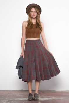 Spin through the cooling weather in this flowy, plaid skirt by sustainable company CP Shades. - By CP Shades - 100% Linen - Sustainably made - Made in USA - Fit: Relaxed, flowy fit with spandex waist