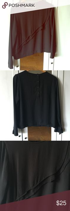 Topshop Ruffle Top Can go from office to happy hour! EUC, this black ruffle top pairs well with black pants/jeans and your favorite booties. Lightweight but semi-sheer almost opaque. Size US 8 but can fit a 10 as it is a little boxy. Only selling because it no longer fits me. Topshop Tops Blouses