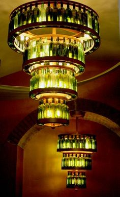 This is really cool although I have no idea where I'd put it! Video for cutting glass wine bottles. Examples for chandelier, plant watering ideas, ends to create lighted mosaic Wine Bottle Chandelier, Bottle Lights, Bottle Candles, Wine Bottle Art, Wine Bottle Crafts, Bar A Vin, Bottle Cutting, Wine Craft, Wine Design
