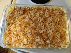 Chicken on the Ritz -6 cups cooked, chopped chicken breasts 2 cans cream of chicken soup 8 ounces sour cream 2 T. poppy seeds 2 pkgs. buttery crackers (I use Ritz) 1/2 cup butter  Mix together the first four ingredients and spoon into a 9x13 baking dish . Crumble the crackers over the top and spoon the melted butter over the crackers. Bake at 350 degrees for 30 min