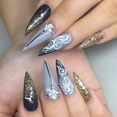 Ombre gold glitter stiletto with white swirl detailing! Beautiful nails by  @jonnydieppham  Ugly Duckling Nails page is dedicated to promoting quality, inspirational nails created by International Nail Artists  #nailartaddict #nailswag #nailaholic  #nailart  #nailsofinstagram  #nai