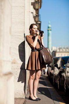 Pretty photographer in brown dress. Paris. The Sartorialist.