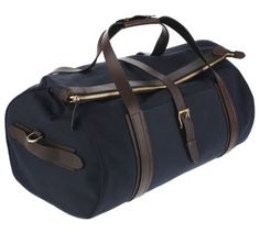 The bag is perfection in waterproof, navy blue canvas and dark brown leather.