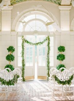 lush & lovely white and green ceremony decorations.