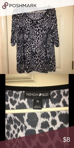 Fashion Bug Animal Print Top 1X Black and white animal print dress top. 3/4 sleeves.  Size 1X.  Fashion Bug.  Excellent condition.  Important:   All items are freshly laundered as applicable prior to shipping (new items and shoes excluded).  Not all my items are from pet/smoke free homes.  Price is reduced to reflect this!   Thank you for looking! Fashion Bug Tops Blouses