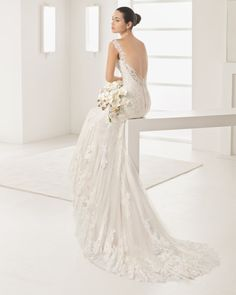 Mermaid-style lace dress with sweetheart neckline and low back, in nude and natural.