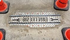 Chicago artist Jim Bachor turns street potholes into mosaic art