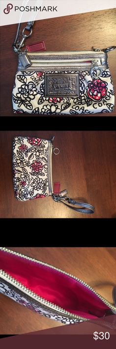 Satin Coach Wristlet White satin with dark pink and black designs; silver accents; strap can be used as a wristlet or connected to both sides like a small purse. Small stain on the back and near the zipper. Not very noticeable. Coach Bags Clutches & Wristlets