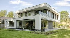 Moderne villa - trendy met natuurstenen van Rustico Wonen.nl Van der Padt&Partners Architecten,