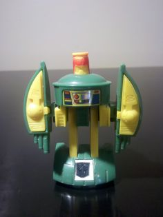 Transformers: Cosmos. Another cool mini, and yet another example of how the scale on the original series was so messed up. Somehow Cosmos grew to a gargantuan enough size that Perceptor and Blaster could fit inside him comfortably. I suppose I shouldn't fuss too much about that since Astrotrain could carry all the Decepticons, but still required a reduction in weight in zero gravity. When you're a kid---physics just don't matter! That begs the question: does physics really matter now?