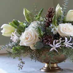 beautiful winter centerpieces | beautiful winter centerpiece of white amaryllis, ... | Centerpieces