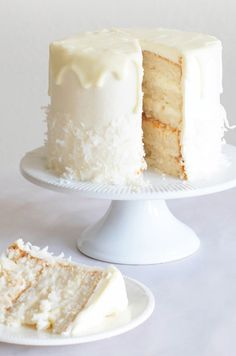 RAFFAELLO CAKE ~~~ the many, many versions of a raffaello cake, stemming from the flavor profile of a raffaello confection, are beyond tracking. the share at this post's link is that of a layered construct made of flourless coconut and almond sponge in creamy white chocolate frosting and coconut flake garnish. [sugaryandbuttery]