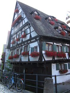 Traditional German house. Endless flower boxes on the windowsills. Reminds me of my parents home town. :D
