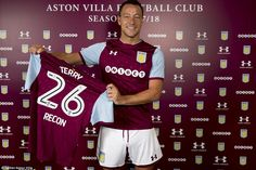 July 3rd. 2017 : John Terry holds up the No 26 shirt that was so familiar to him at Chelsea as he moves to Villa Park