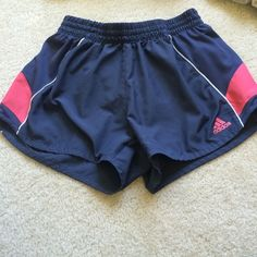 Adidas grey and pink shorts great condition, built in underwear, white stop along the sides Adidas Shorts