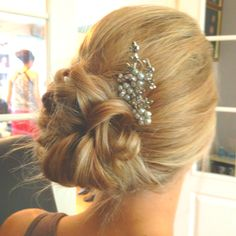 Adorable updo for Heidi's wedding but with a pink flower, perhaps?