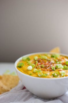 Vegan Queso Hummus: An addictive cheesy dip that's free from dairy and gluten! Made from healthy, whole food ingredients, and it's the perfect football food! || fooduzzi.com recipe