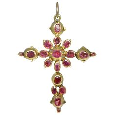 Antique Georgian Ruby Cross. What an amazing, historic piece this is! An antique Georgian Cross handmade 9k yellow gold and set with 16 rubies (5.0tcw). Dimensions: 4.5cm tall x 3.5cm wide x 0.5cm deep. This unique pendant is a gorgeous representation of the craftsmanship of the Old World jewelers and will surely be Treasured as an heirloom in years to come! c 1700s
