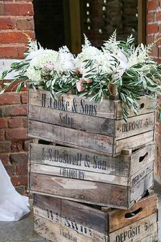 shustoke farm barns wedding flowers passion for flowers wooden rustic crates with flowers in barn