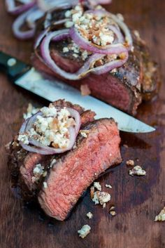 Juicy steak topped with red onions.
