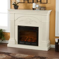 Thinking of getting this for the living room - Boston Loft Furnishings 44.75-in W 4,700-BTU Ivory Wood Fan-Forced Electric Fireplace with Thermostat and Remote Control